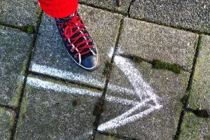 foot next to chalked arrow